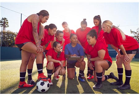 coach-with-digital-tablet-discussing-tactics-with--9NC8VZJ